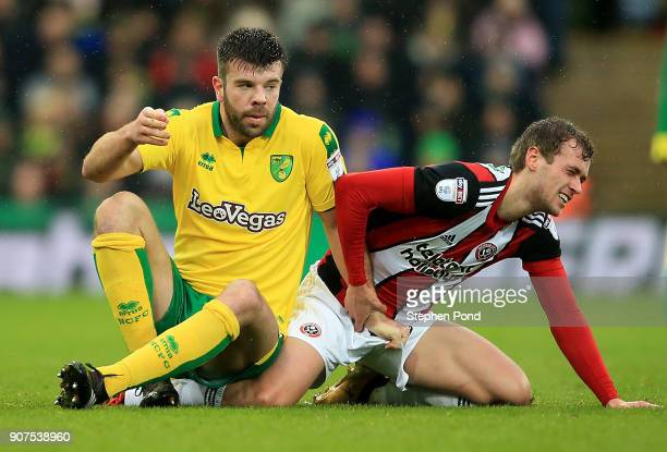Grant Hanley of Norwich City tangels with James Wilson of Sheffield United during the Sky Bet Championship match between Norwich City and Sheffield...