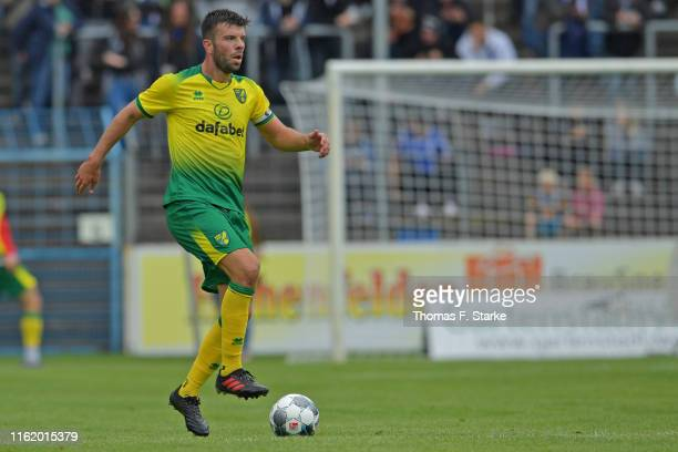 Grant Hanley of Norwich runs with the ball during the pre-season friendly match between DSC Arminia Bielefeld and Norwich City at Energieversum...