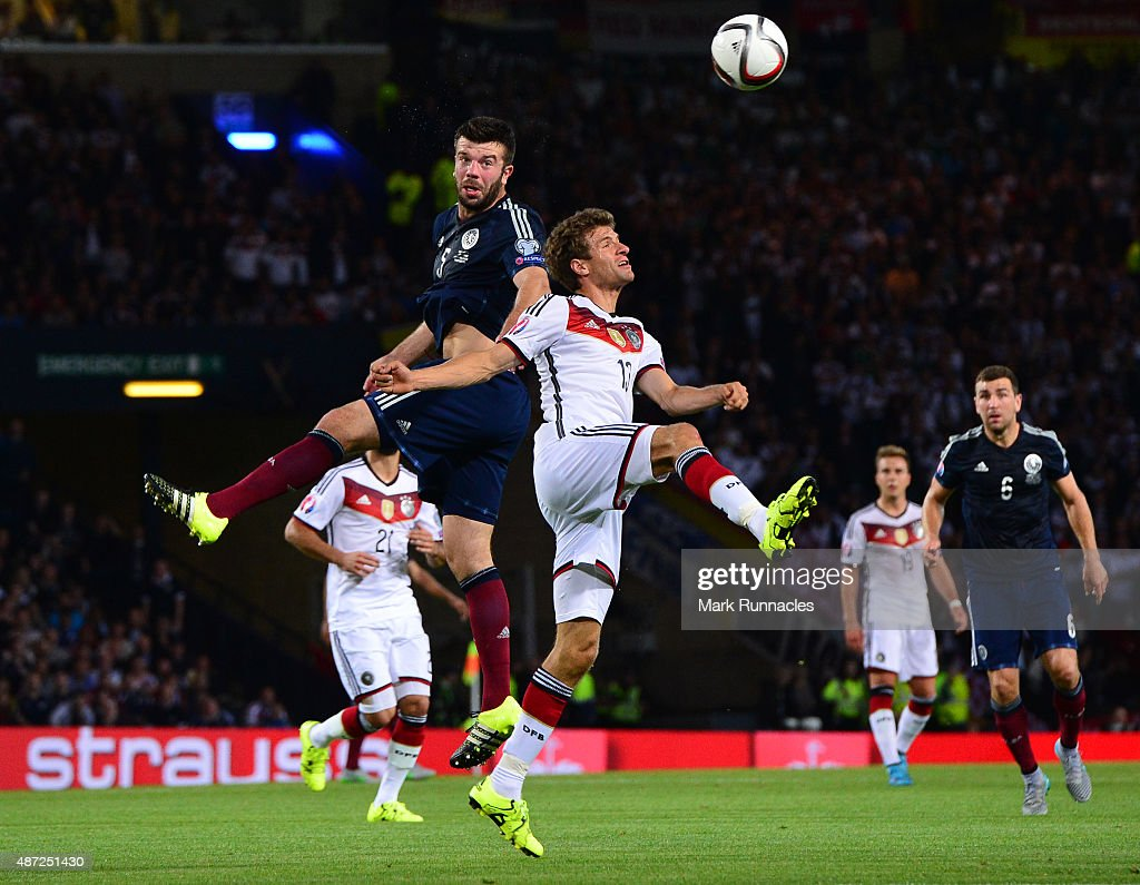 Grant Hanley of Scotland challenges Thomas Muller of Germany during the EURO 2016 Qualifier between Scotland and Germany at Hamden Park on September 7, 2015 in Glasgow, Scotland.