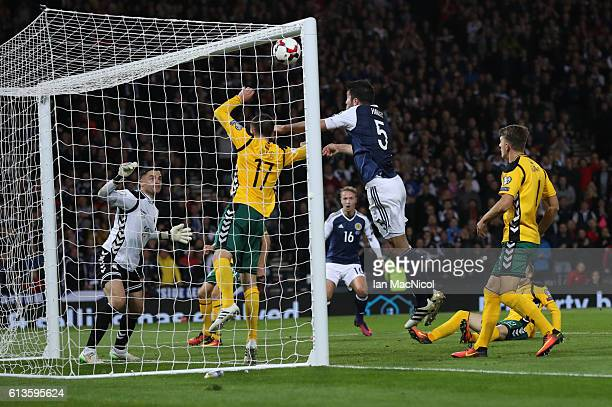 Grant Hanley of Scotland heads over the bar during the FIFA 2018 World Cup Qualifier between Scotland and Lithuania at Hampden Park on October 8 2016...