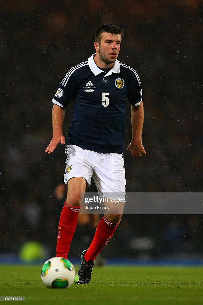 Grant Hanley of Scotland in action during the FIFA 2014 World Cup Qualifying Group A match between Scotland and Belgium at Hampden Park on September 6, 2013 in Glasgow, Scotland.