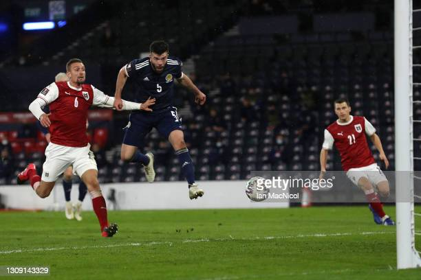 Grant Hanley of Scotland scores their side's first goal during the FIFA World Cup 2022 Qatar qualifying match between Scotland and Austria on March...