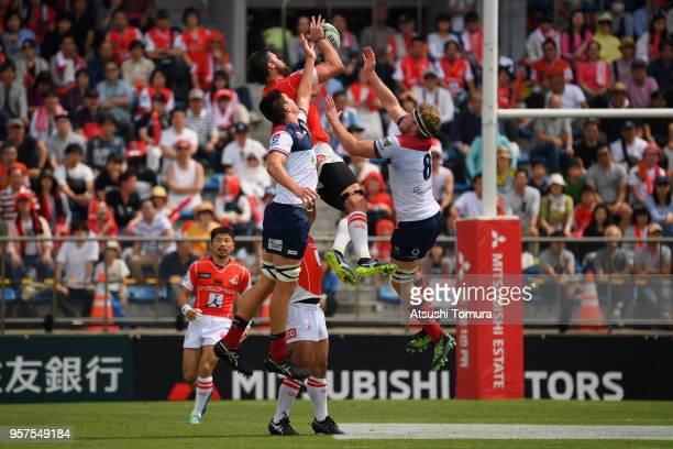 Grant Hattingh of the Sunwolves and Angus ScottYoung of the Reds compete for the ball during the Super Rugby match between Sunwolves and Reds at...