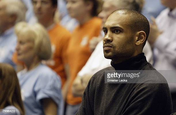 Grant Hill, a former Duke Blue Devil and current Orlando Magic player, watches the game as his alma mater takes on the University of North Carolina...