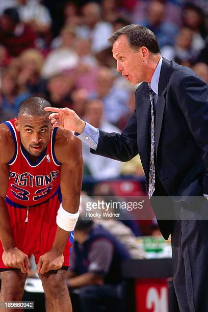 Grant Hill and Doug Collins of the Detroit Pistons talk against the Sacramento Kings during a game played on October 17 1996 at Arco Arena in...