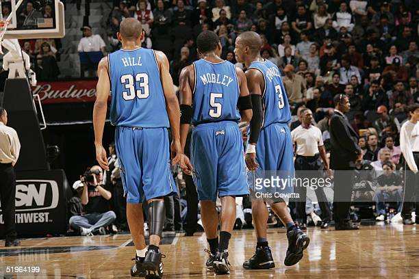Grant Hill Cuttino Mobley and Steve Francis of the Orlando Magic walk the court December 15 2004 at the SBC Center in San Antonio Texas The Spurs won...