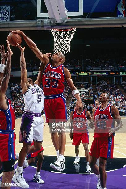 Grant Hill of the Detroit Pistons blocks a shot attempt against the Sacramento Kings during a game played on October 17 1996 at Arco Arena in...