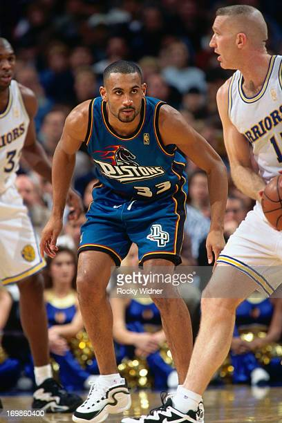 Grant Hill of the Detroit Pistons defends against the Golden State Warriors during a game played on January 23 1997 at the San Jose Arena in San Jose...