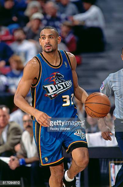 Grant Hill of the Detroit Pistons dribbles against the Sacramento Kings on January 22 1997 at Arco Arena in Sacramento California NOTE TO USER User...