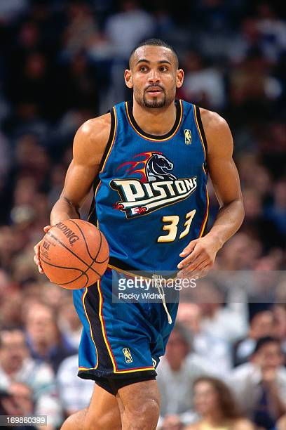 Grant Hill of the Detroit Pistons dribbles the ball against the Golden State Warriors during a game played on January 23 1997 at the San Jose Arena...