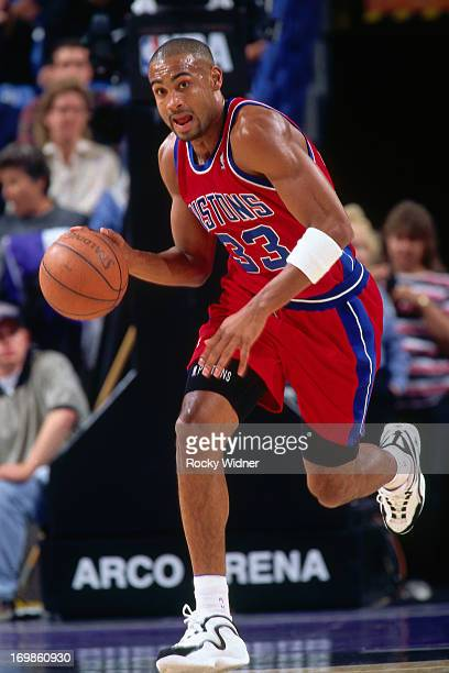 Grant Hill of the Detroit Pistons dribbles the ball against the Sacramento Kings during a game played on October 17 1996 at Arco Arena in Sacramento...
