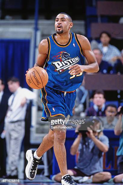 Grant Hill of the Detroit Pistons drives against the Golden State Warriors on November 12 1997 at Oracle Arena in Oakland California NOTE TO USER...