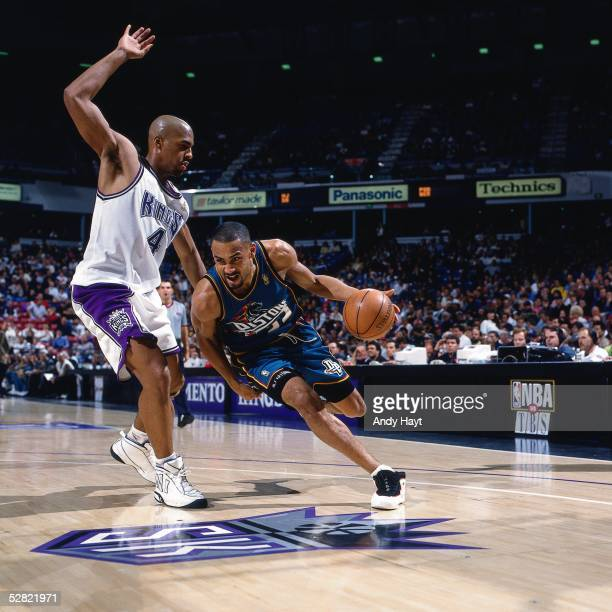 Grant Hill of the Detroit Pistons drives against the Sacramento Kings during the NBA game on January 22 1997 in Sacramento California NOTE TO USER...