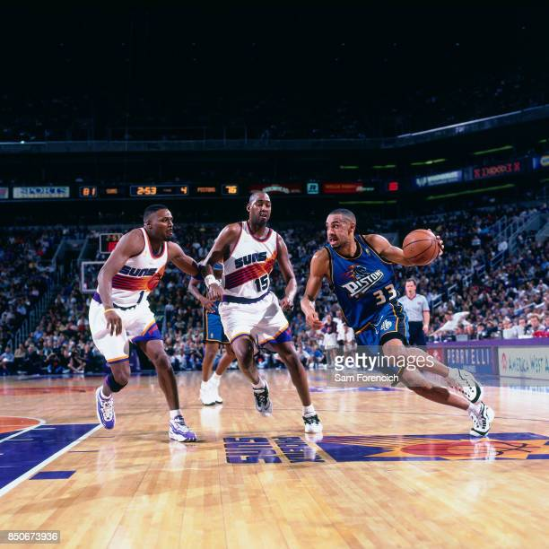 Grant Hill of the Detroit Pistons drives against the Sacramento Kings circa 1997 at America West Arena in Phoenix Arizona NOTE TO USER User expressly...