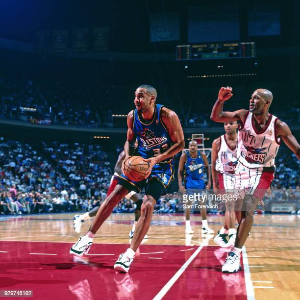 Grant Hill of the Detroit Pistons drives circa 1997 at the Compaq Center in Houston Texas NOTE TO USER User expressly acknowledges and agrees that by...