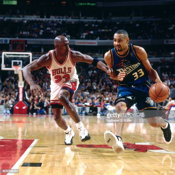 Grant Hill of the Detroit Pistons drives during a game played on March 22 1997 at the United Center in Chicago Illinois NOTE TO USER User expressly...