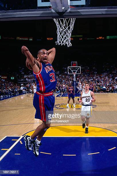 Grant Hill of the Detroit Pistons dunks against the Golden State Warriors circa 1995 at the OaklandAlameda County Coliseum Arena in Oakland...