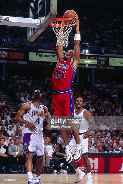 Grant Hill of the Detroit Pistons dunks against the Sacramento Kings during a game played on October 17 1996 at Arco Arena in Sacramento California...