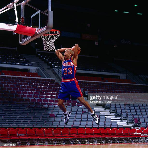 Grant HIll of the Detroit Pistons dunks circa 1995 at the Palace of Auburn Hills in Auburn Hills Michigan NOTE TO USER User expressly acknowledges...