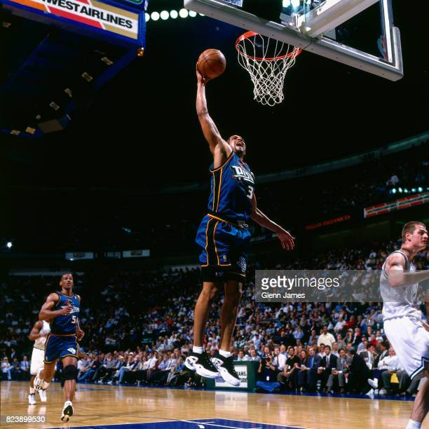 Grant Hill of the Detroit Pistons dunks the ball against the Dallas Mavericks at the Reunion Arena in Dallas Texas crica 1997 NOTE TO USER User...