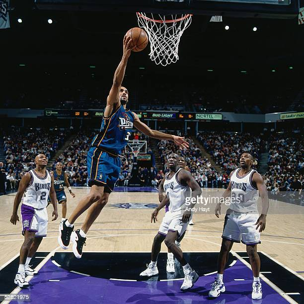 Grant Hill of the Detroit Pistons goes for a layup against the Sacramento Kings during the NBA game on January 22 1997 in Sacramento California NOTE...