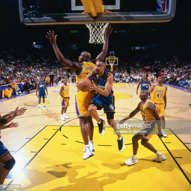 Grant Hill of the Detroit Pistons goes to the basket against the Los Angeles Lakers on January 18 1997 at the Great Western Forum in Inglewood...
