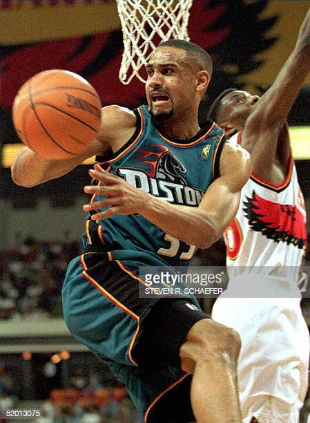 Grant Hill of the Detroit Pistons grabs a rebound away from Atlanta Hawks player Steve Smith during the fifth and deciding game of their firstround...