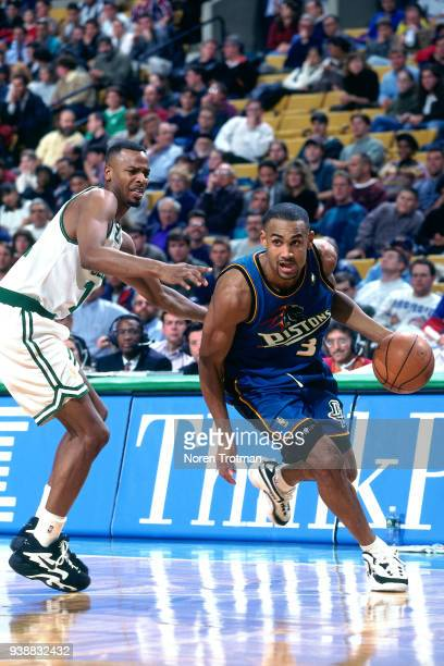 Grant Hill of the Detroit Pistons handles the ball against the Boston Celtics on February 28 1997 at the FleetCenter in Boston Massachusetts NOTE TO...