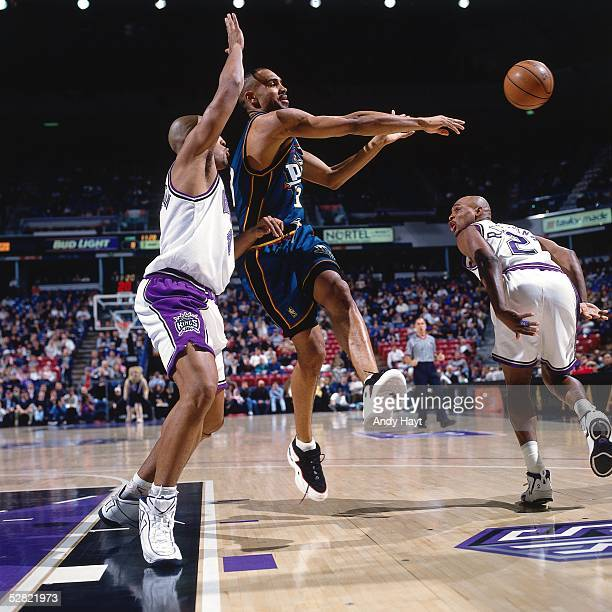 Grant Hill of the Detroit Pistons makes a pass against the Sacramento Kings during the NBA game on January 22 1997 in Sacramento California NOTE TO...