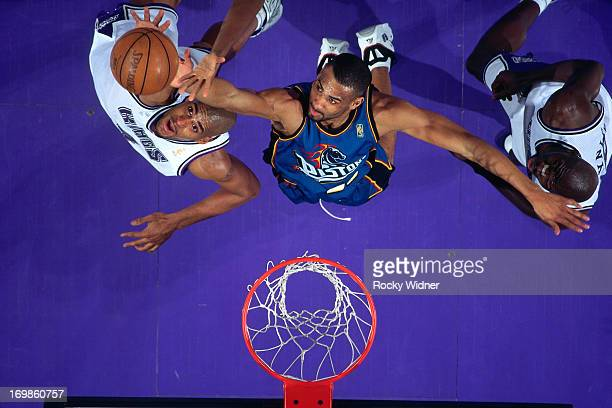 Grant Hill of the Detroit Pistons rebounds against the Sacramento Kings during a game played on January 22 1997 at Arco Arena in Sacramento...