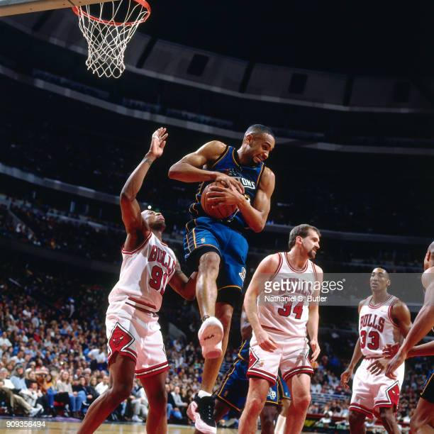 Grant Hill of the Detroit Pistons rebounds during a game played on March 22 1997 at the United Center in Chicago Illinois NOTE TO USER User expressly...