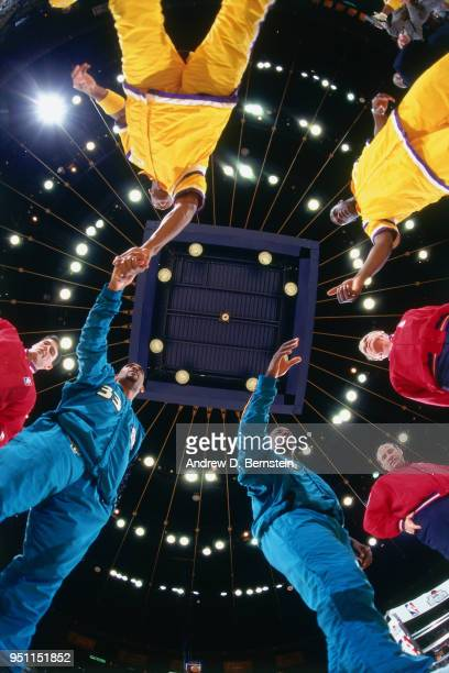 Grant Hill of the Detroit Pistons shakes hands before the game against the Los Angeles Lakers on January 18 1997 at the Great Western Forum in...