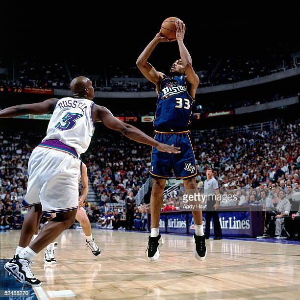Grant Hill of the Detroit Pistons shoots a jump shot against the Utah Jazz during an NBA game on March 7 1997 at the Delta Center in Salt Lake City...