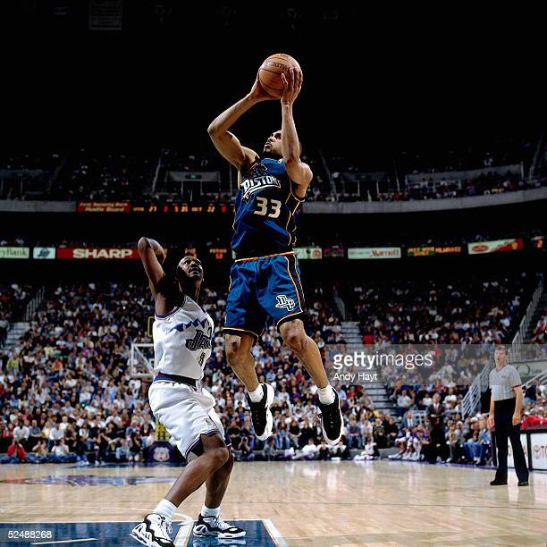 Grant Hill of the Detroit Pistons shoots a jumpshot against the Utah Jazz during an NBA game on March 7 1997 at the Delta Center in Salt Lake City...