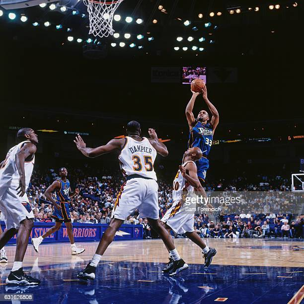 Grant Hill of the Detroit Pistons shoots against the Golden State Warriors on November 12 1997 at Oracle Arena in Oakland California NOTE TO USER...