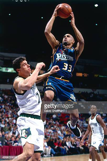 Grant Hill of the Detroit Pistons shoots against the Minnesota Timberwolves during a game played circa 1997 at the Target Center in Minneapolis...