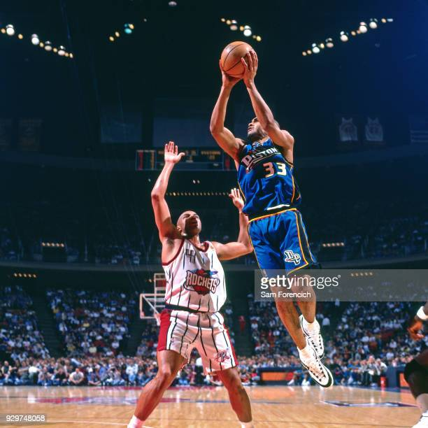 Grant Hill of the Detroit Pistons shoots circa 1997 at the Compaq Center in Houston Texas NOTE TO USER User expressly acknowledges and agrees that by...