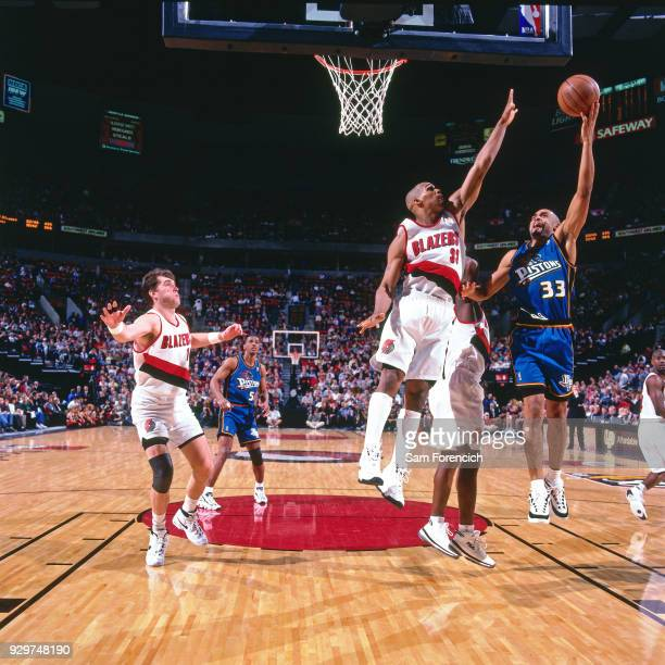 Grant Hill of the Detroit Pistons shoots circa 1997 at the Rose Garden in Portland Oregon NOTE TO USER User expressly acknowledges and agrees that by...