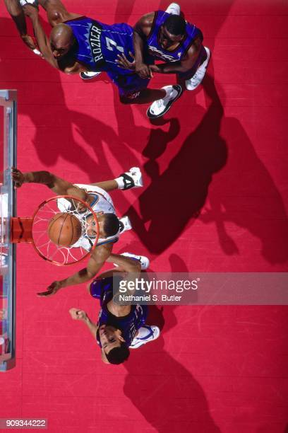 Grant Hill of the Detroit Pistons shoots during a game played on March 19 1997 at the Palace of Auburn Hills in Auburn Hills Michigan NOTE TO USER...