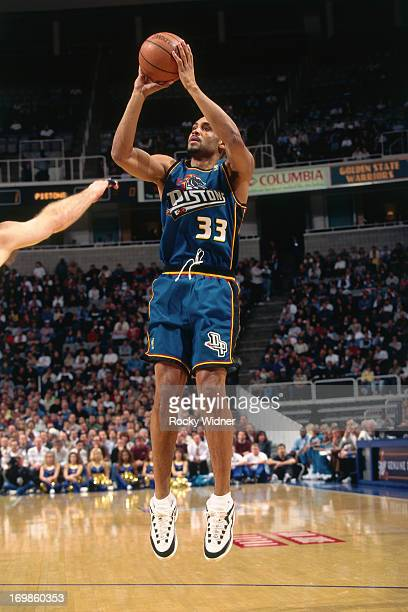Grant Hill of the Detroit Pistons shoots the ball against the Golden State Warriors during a game played on January 23 1997 at the San Jose Arena in...