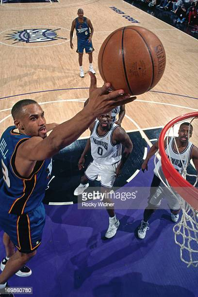 Grant Hill of the Detroit Pistons shoots the ball against the Sacramento Kings during a game played on January 22 1997 at Arco Arena in Sacramento...