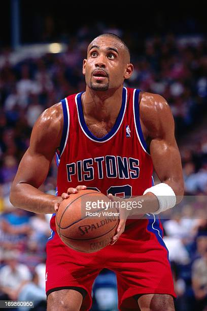 Grant Hill of the Detroit Pistons shoots the ball against the Sacramento Kings during a game played on October 17 1996 at Arco Arena in Sacramento...