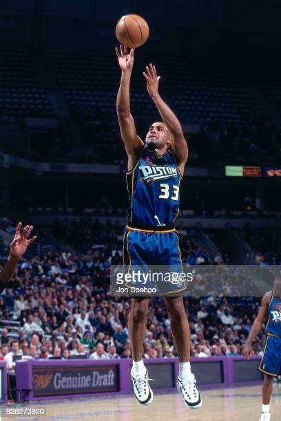 Grant Hill of the Detroit Pistons shoots the ball against the Sacramento Kings during the game circa 1998 at Arco Arena in Sacramento California NOTE...