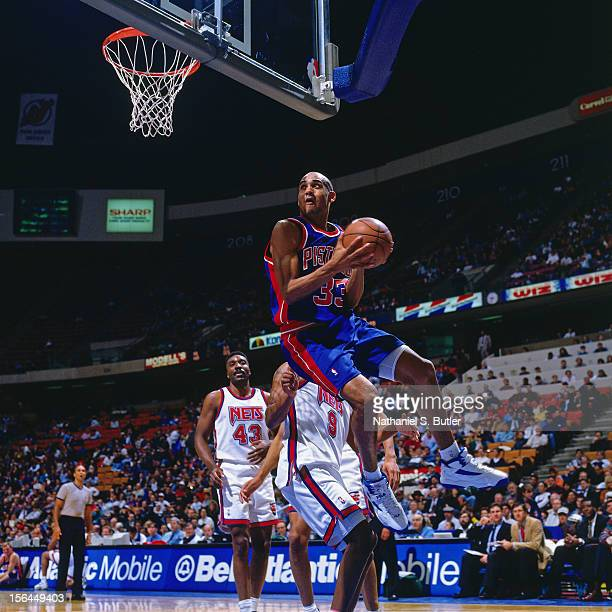 Grant Hill of the Detroit Pistons shoots the ball against the New Jersey Nets during a game played circa 1998 at the Continental Airlines Arena in...