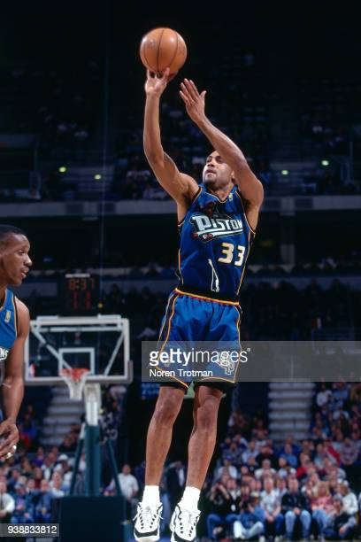 Grant Hill of the Detroit Pistons shoots the ball at the Palace of Auburn Hills in Auburn Hills Michigan NOTE TO USER User expressly acknowledges and...