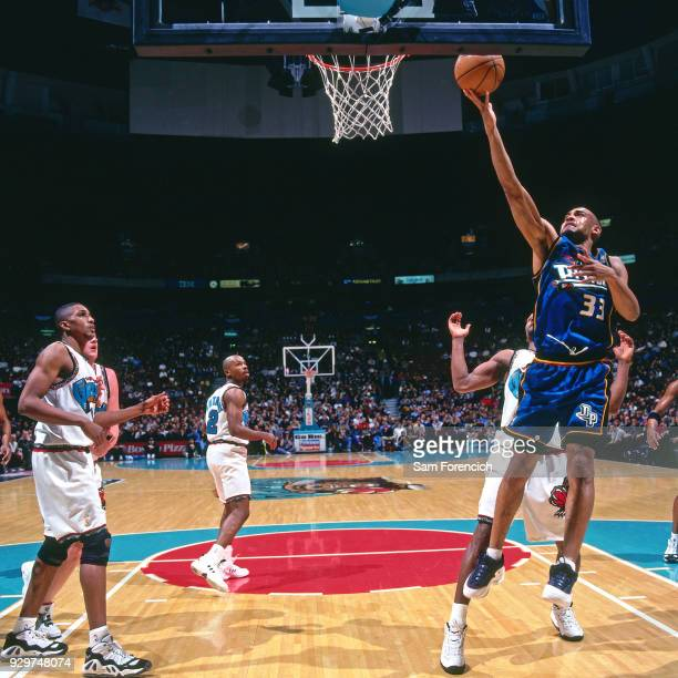 Grant Hill of the Detroit Pistons shots circa 1997 at General Motors Palace in Vancouver Canada NOTE TO USER User expressly acknowledges and agrees...