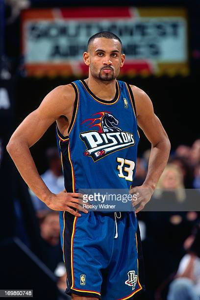 Grant Hill of the Detroit Pistons talks against the Sacramento Kings during a game played on January 22 1997 at Arco Arena in Sacramento California...