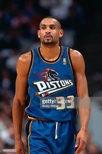 Grant Hill of the Detroit Pistons walks against the Golden State Warriors during a game played on January 23 1997 at the San Jose Arena in San Jose...
