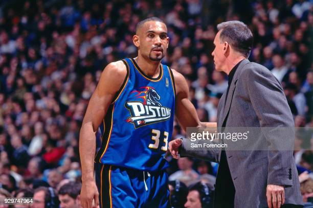 Grant Hill of the Detroit Pistons walks circa 1997 at America West Arena in Phoenix Arizona NOTE TO USER User expressly acknowledges and agrees that...