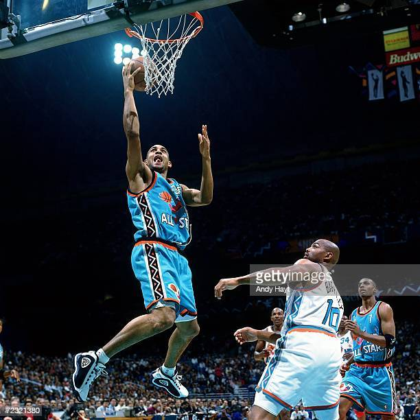 Grant Hill of the Eastern Conference All Stars shoots a layup against Charles Barkley of the Western Conference All Stars during the 1996 NBA All...